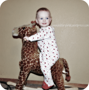 Mr. Blue Eyes on his rocking Giraffe