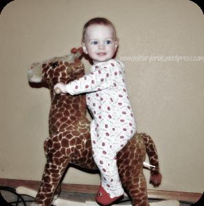 Mr. Blue Eyes on his rocking Giraffe