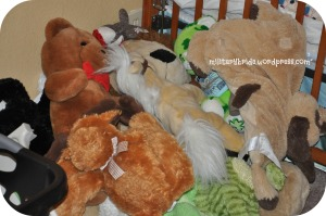 Piled stuffed animals in a corner
