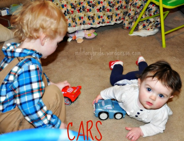 Blue Eyes and Snow White playing with cars